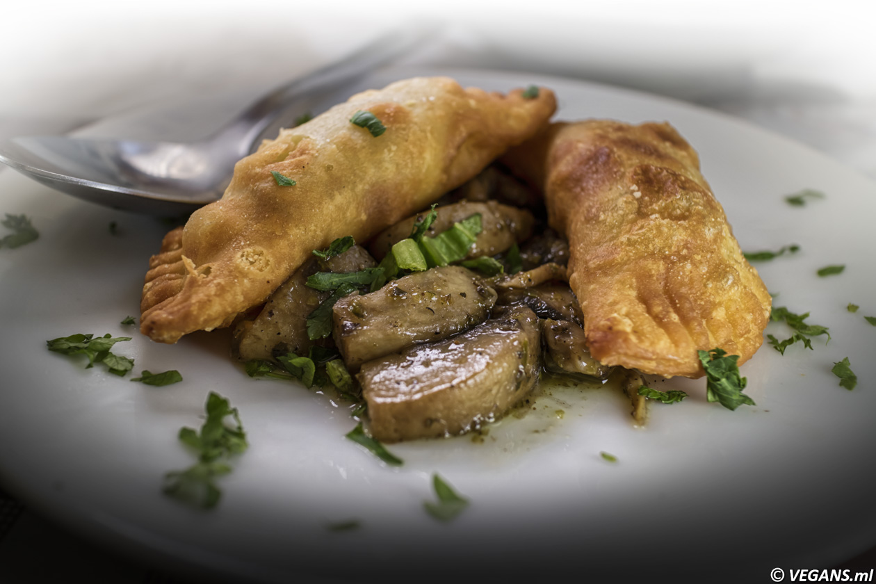 Cypriot vegan Empanadas filled with mushrooms puree served with fried mushrooms.